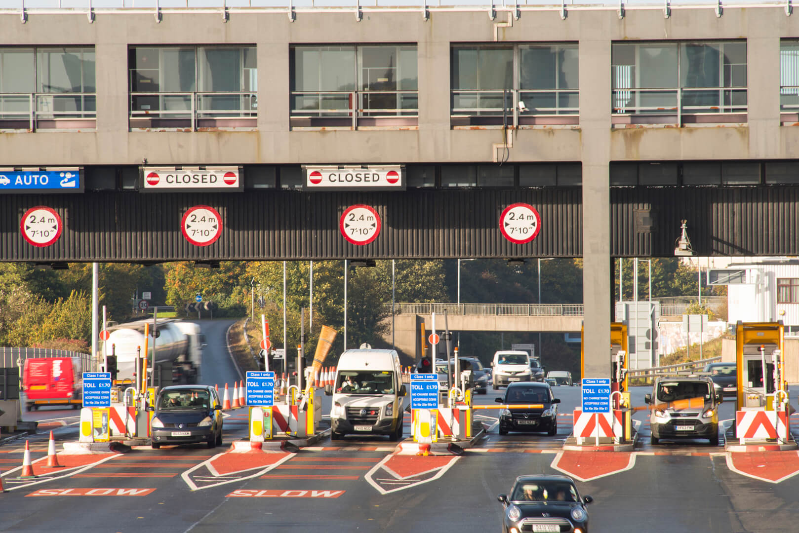 Cars approaching tunnel toll booths